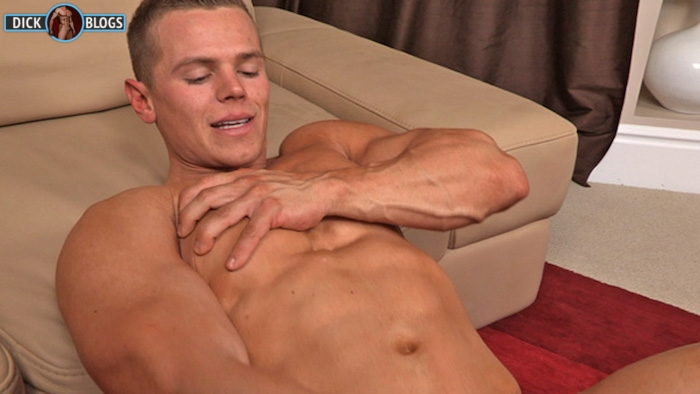 bodybuilder stroking his cock
