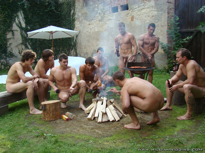 Naked Man Warms His Backside By A Campfire