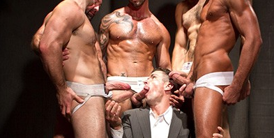 Trenton Ducati sucking five cocks at Raging Stallion