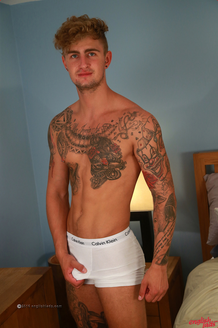 Straight tattooed guy Danny McCaw grabs his cock through his boxer shorts in his dildo play photo shoot