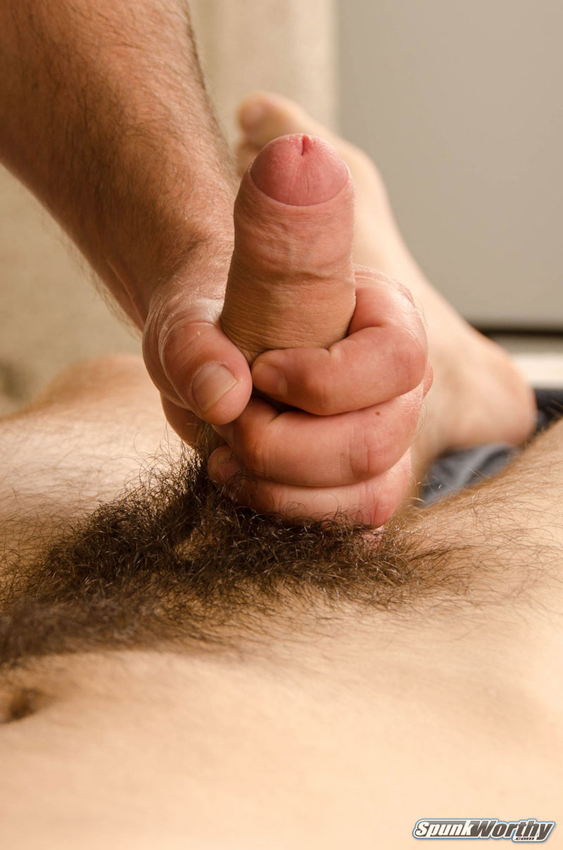 Uncut cock being jerked by another man