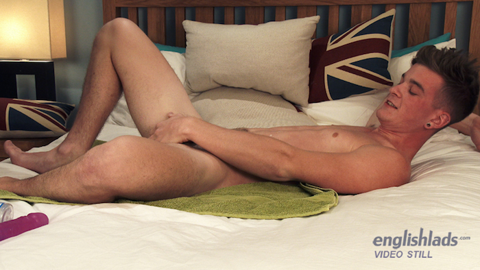 Straight boy Caspar Hamilton wanking his hard uncut cock and fucking his arse with a dildo