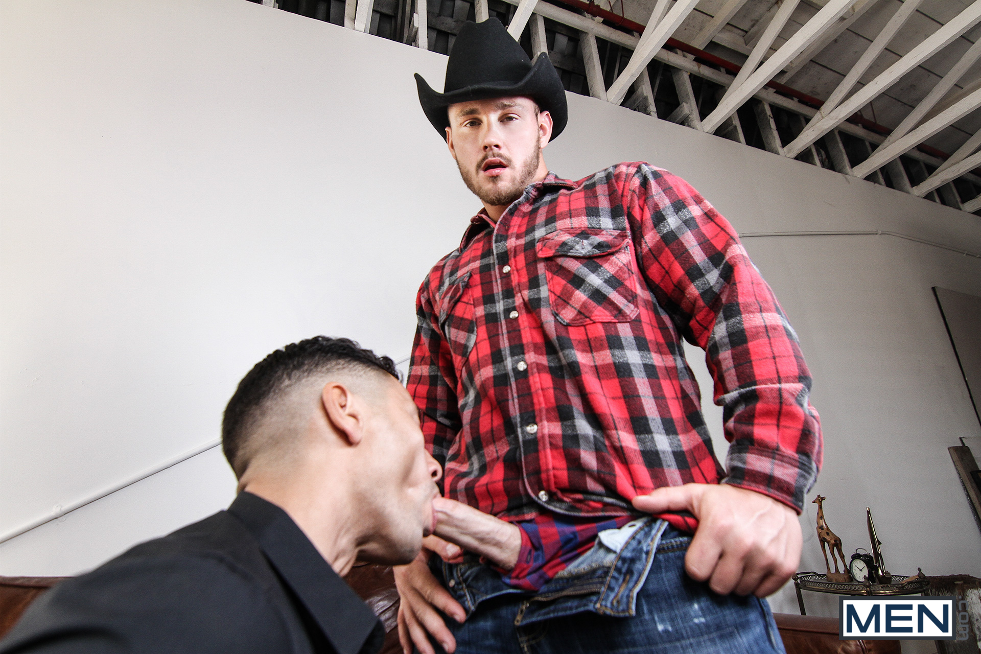 Gay man sucking a cowboy cock