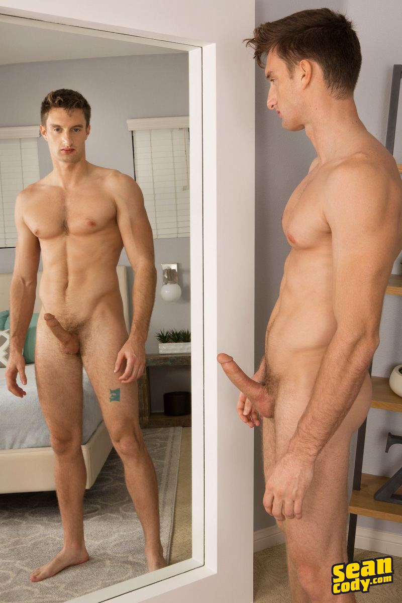horny jock with a hard cock in a mirror