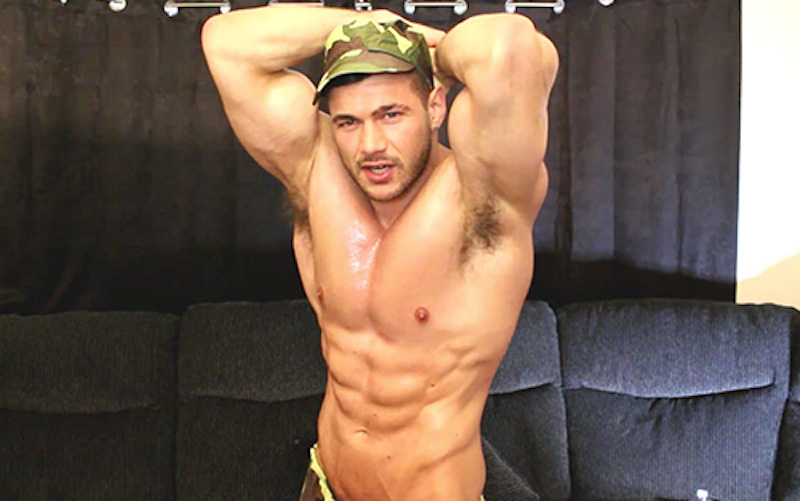 Military muscle hunk showing off his muscles