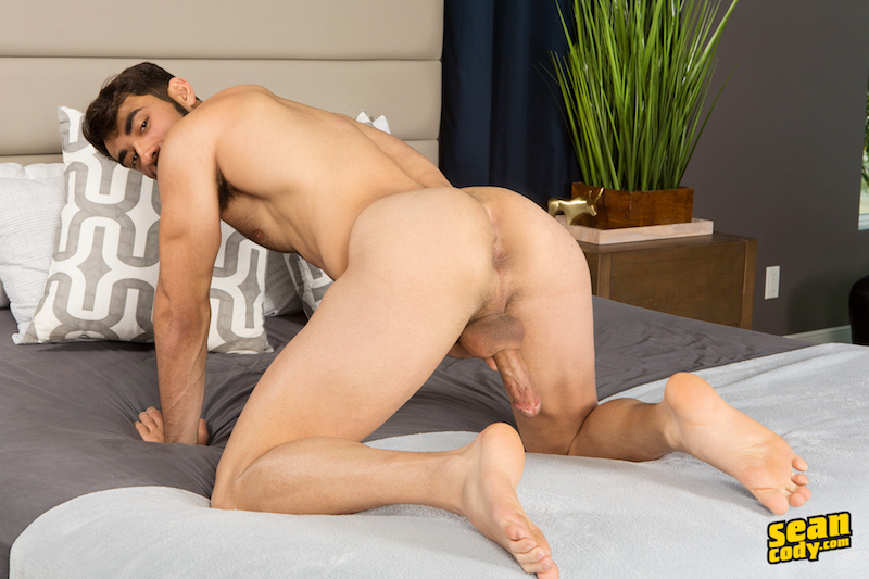 Hard cock through his legs while showing his ass