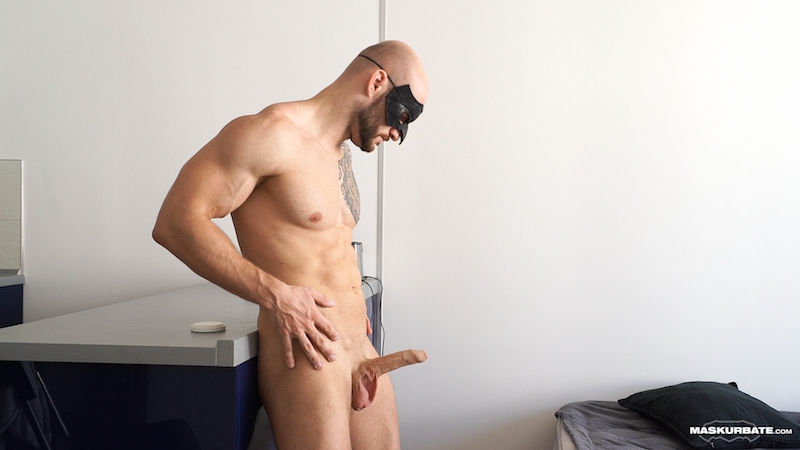 Naked muscle man with an uncut cock