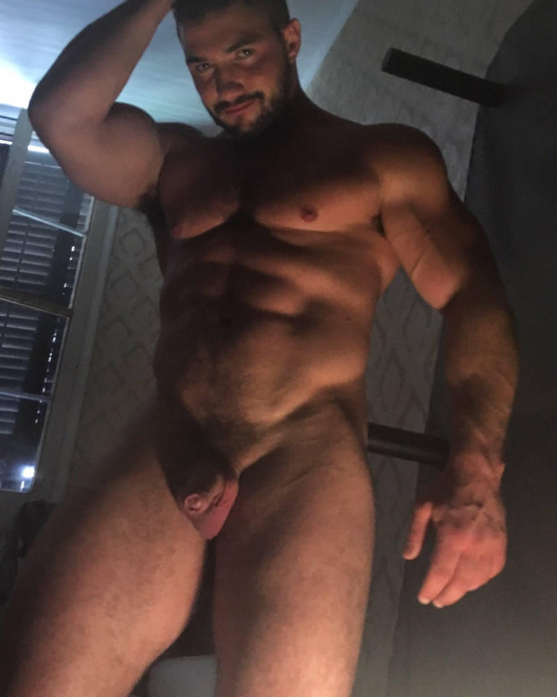 uncut muscle man in the shower