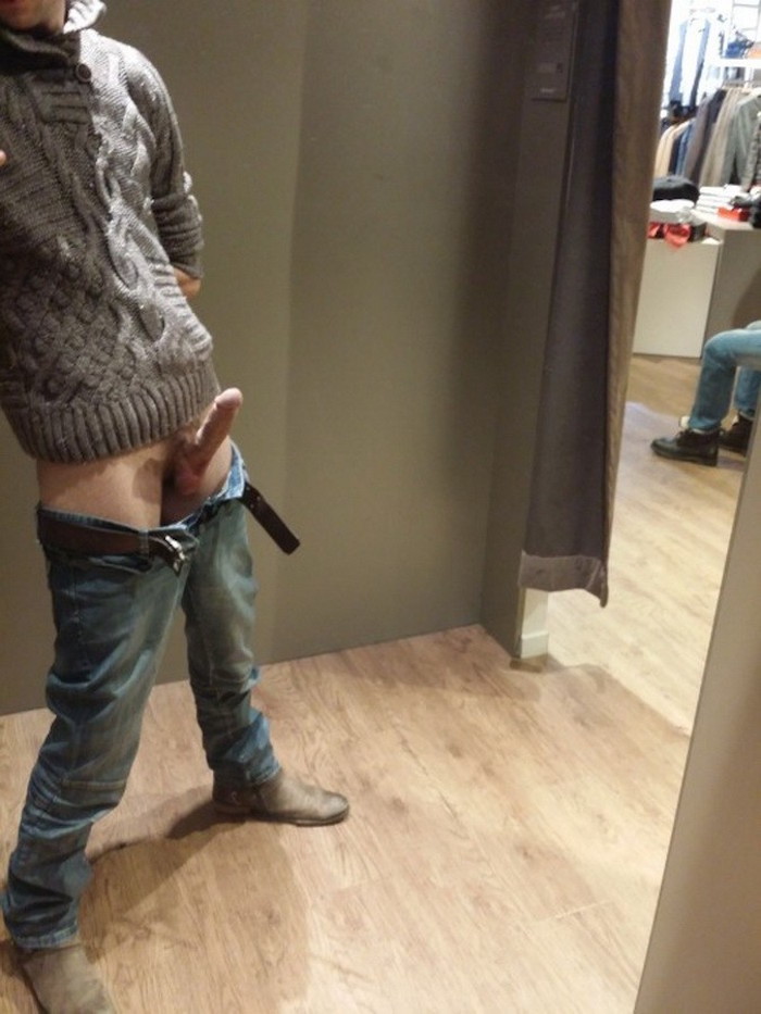 horny guy flashing his hard uncut cock in the changing room