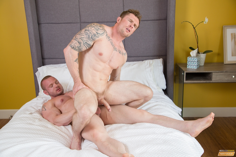 horny muscle man riding another muscle hunk