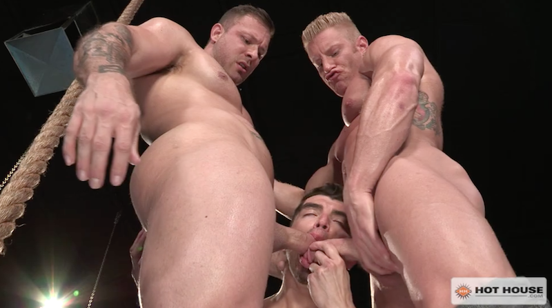 three muscle men sucking cocks in the gym