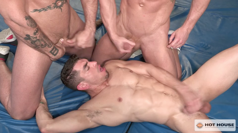two muscle men cum over their buddy after a gym threesome fuck