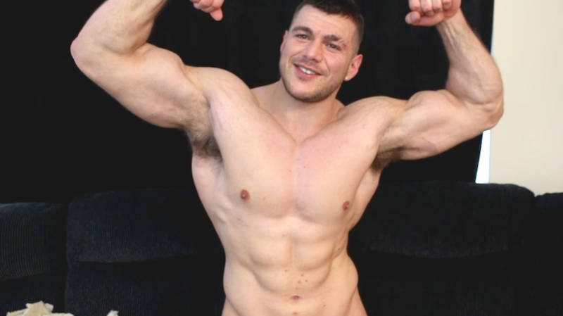 muscle man flexing in a jack off video