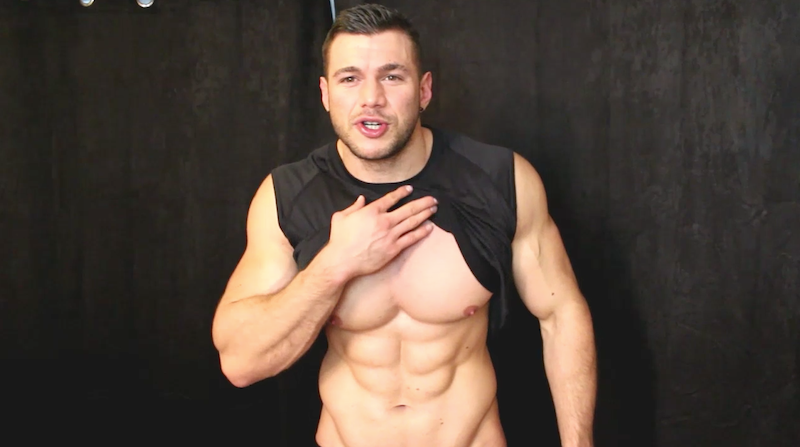 bodybuilder showing his abs in a masturbation video