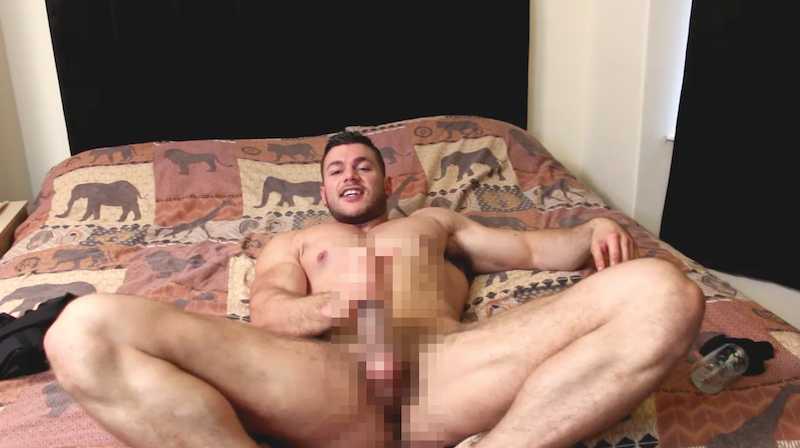 muscle man laying on bed jacking off