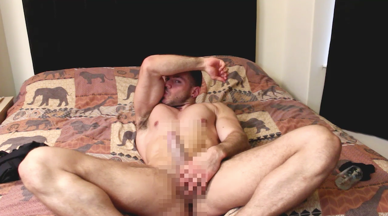 Hard muscle man stroking his long cock