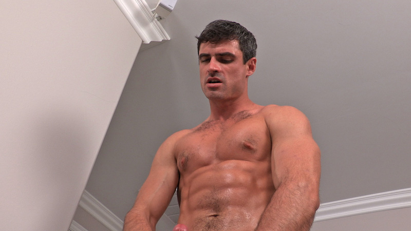 handsome muscled man jacking off