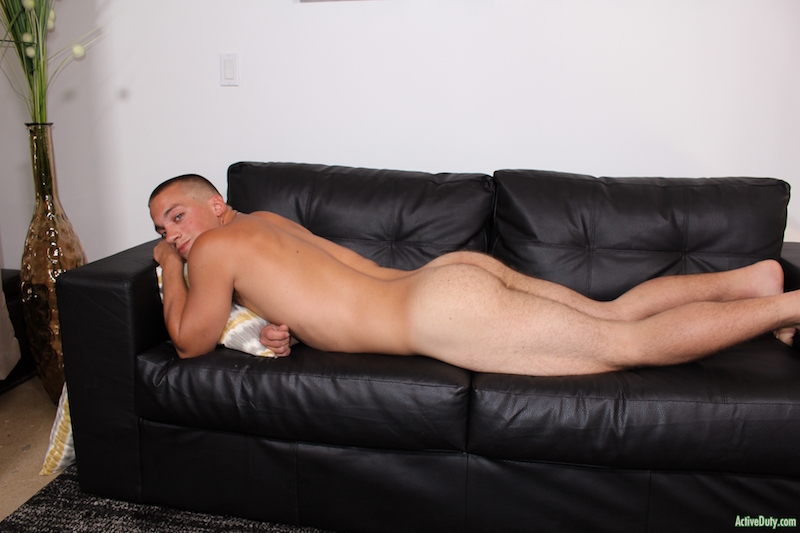 naked military man on a couch