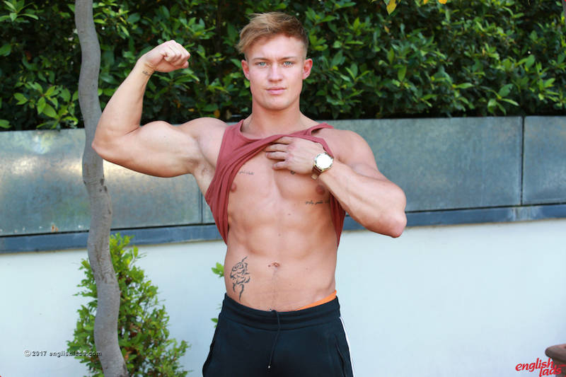 Straight British jock flexing his muscles and showing his abs