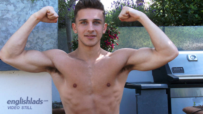 straight boy flexing his muscles outside