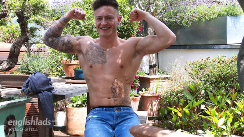 tattooed straight guy flexing