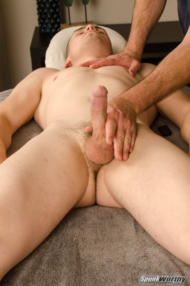straight man hard and being groped by another man on a massage table