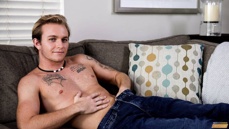 Nervous jock jacking off on a couch