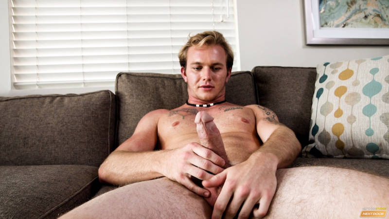 Horny jock jacking off on a couch