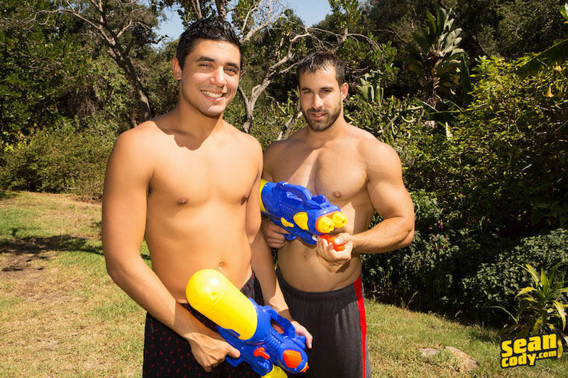 Muscle man and a twink with super soakers