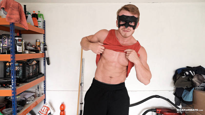 Muscle jock showing his abs while wearing a mask