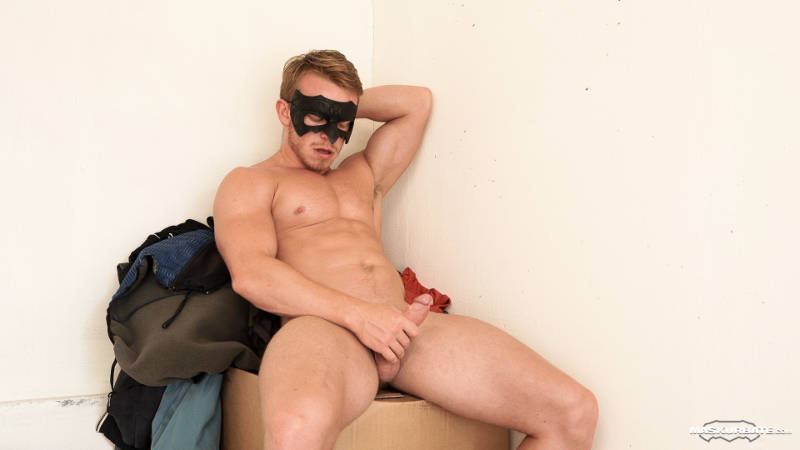 naked muscle jock wearing a mask and jerking off
