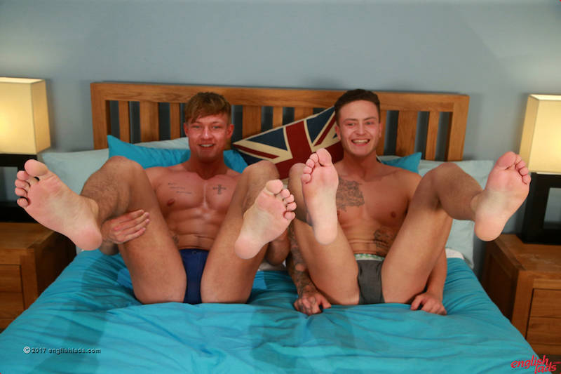 2 straight muscle men showing their feet