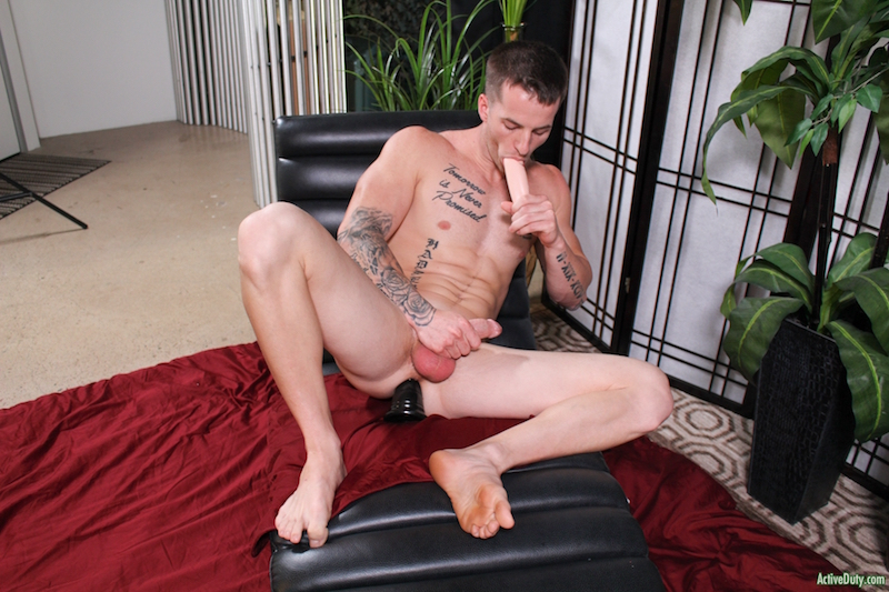naked jock jacking off with a toy in his ass while sucking a dildo