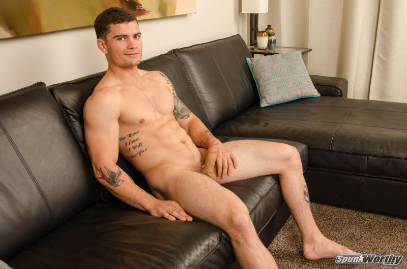 naked muscle hunk with a hard cock on a couch