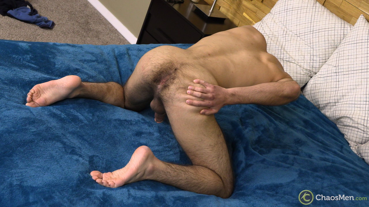 straight guy kneeling on a bed and showing off his hairy ass