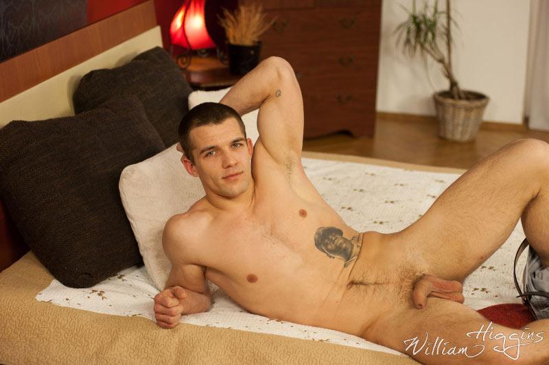 uncut straight jock Ludek Stano laying on a bed at William Higgins