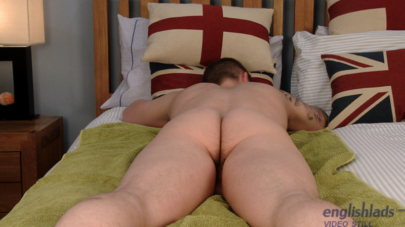 naked straight boy laying face down on a bed showing his butt