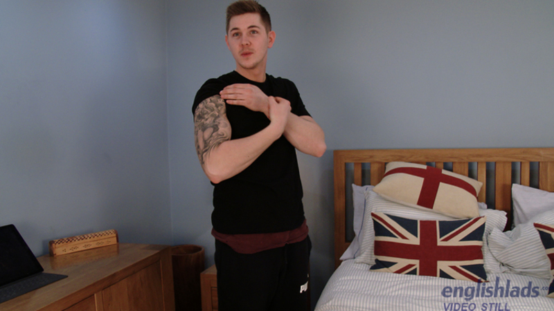 straight boy showing off his arm tattoo in a gay porn video