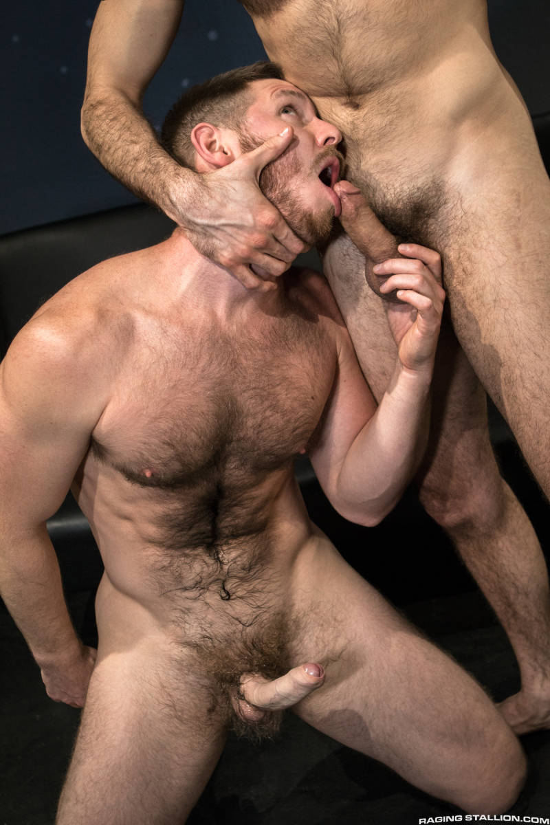 hairy man with a hard uncut cock kneeling on the floor to suck another man