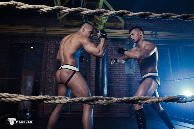two Russian muscle men fighting in a ring for Maskulo
