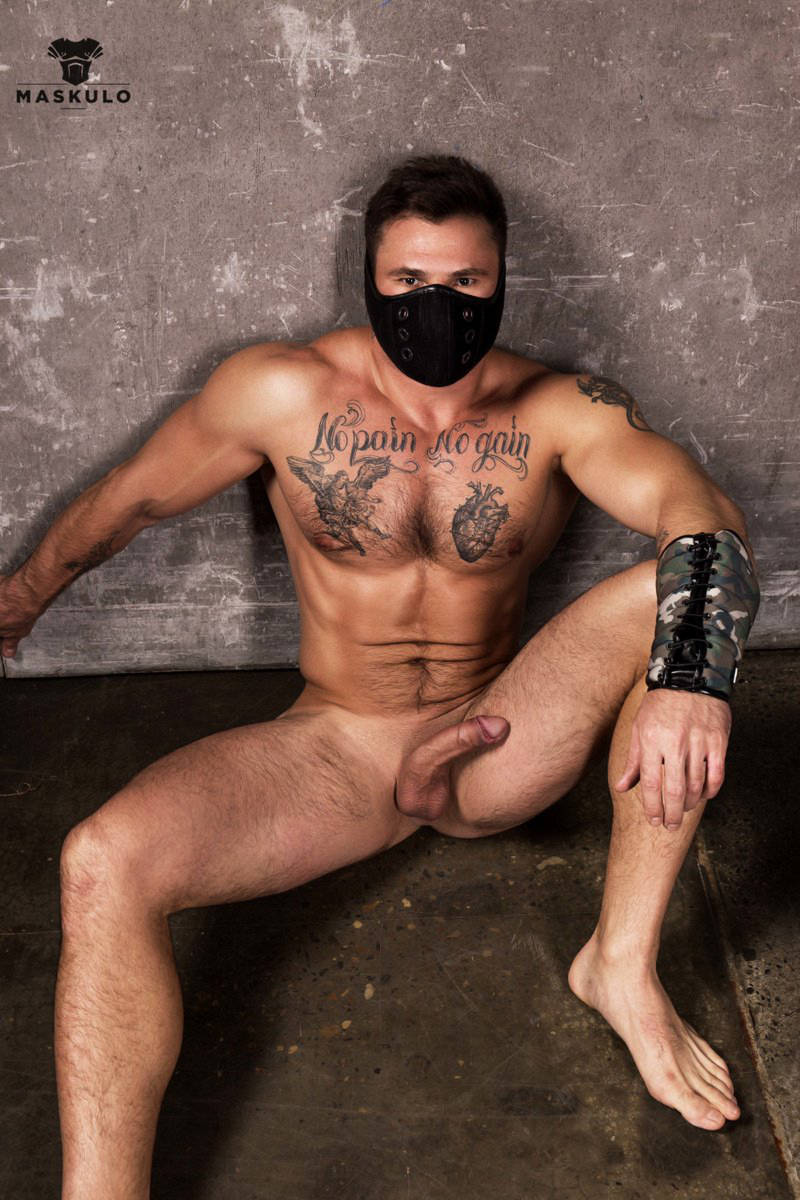 naked muscle man wearing a Maskulo mask and showing his hard uncut cock