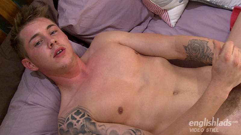 Straight boy laying naked on the bed wanking and ready to cum all over his smooth body