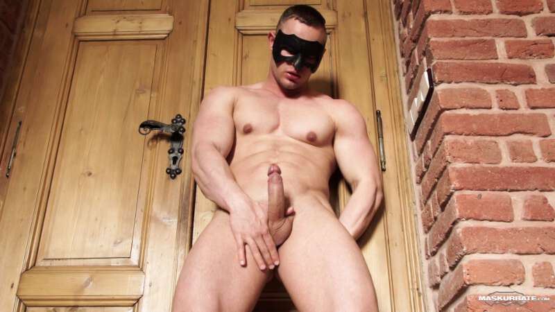 muscle man showing his hard uncut cock