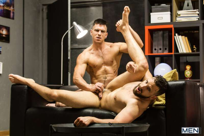 muscle man grabbing balls while fucking his buddy