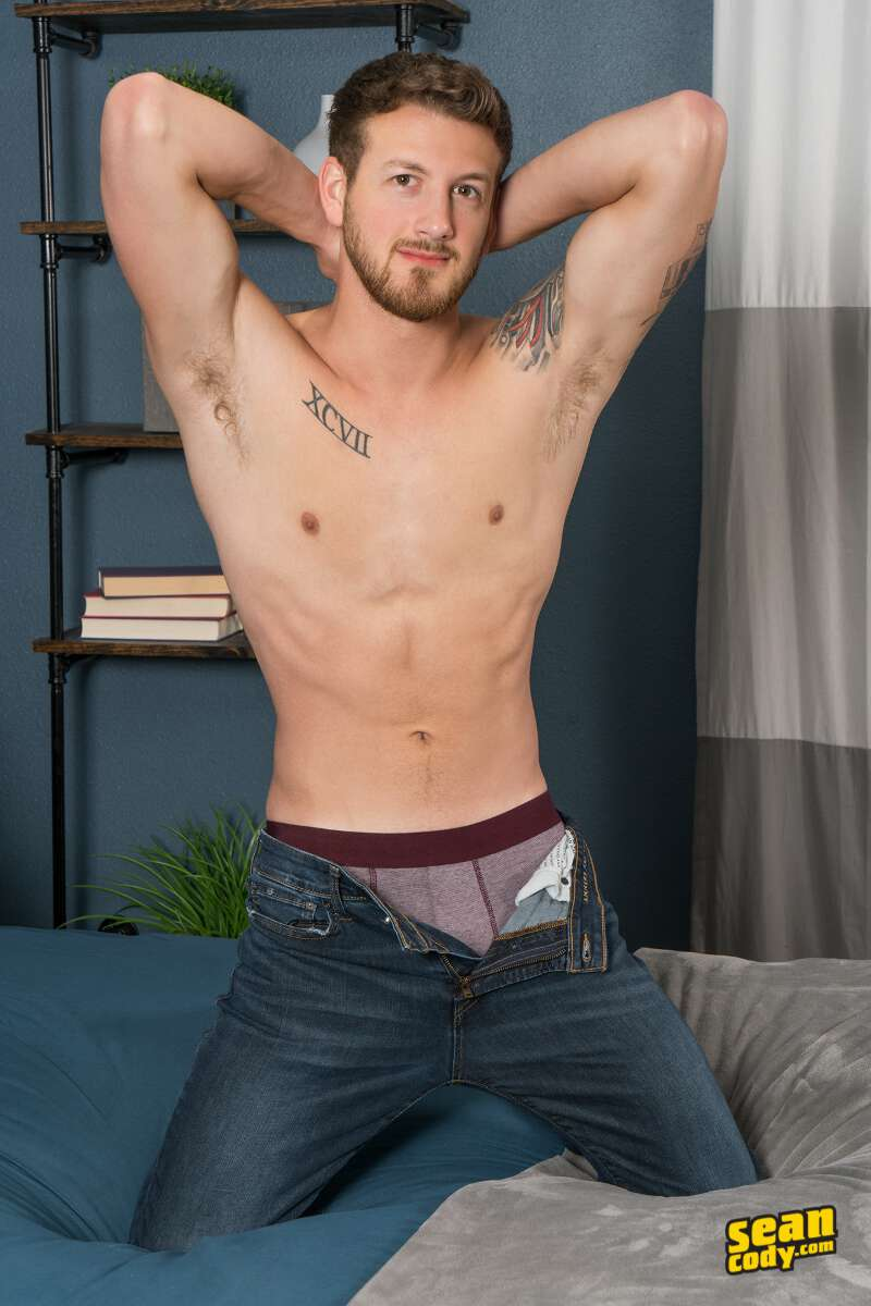 handsome jock posing in unbuttoned jeans