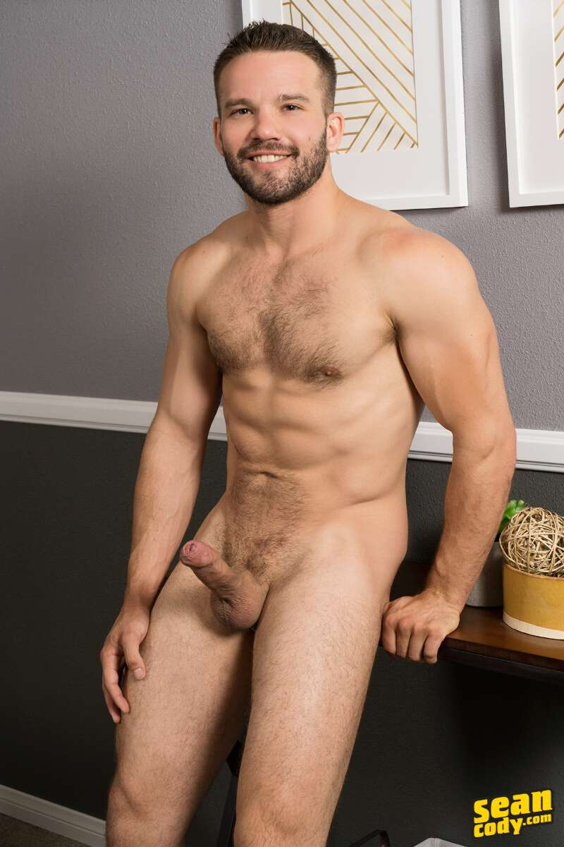 handsome and hairy naked jock standing and showing his intact erection