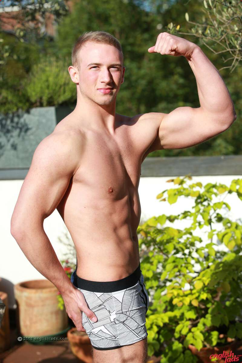 straight muscle boy David Kolar shows off his body in the sun flexing his arm