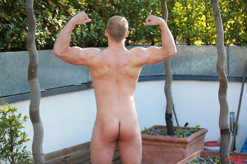 straight muscle lad showing his ass in a naked photo shoot