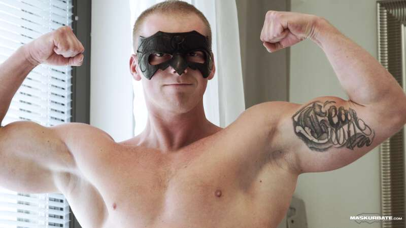masked muscle man flexing his arms
