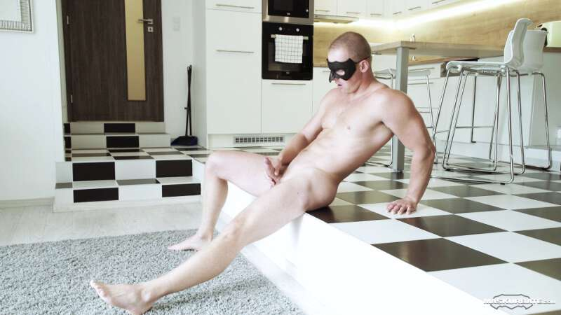 naked masked muscle man sitting on the floor jerking off